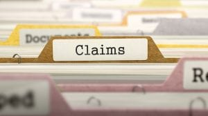 file folders with CLAIMS as the focus tab | outsource medical and insurance billing company