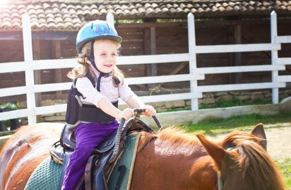Girl riding horse with helmet | Midwest Medical Billing Service New  equine therapy